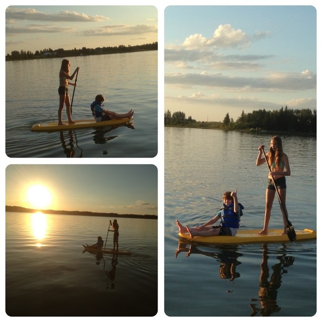 Haley & Nathan Jeynes enjoying a stand up paddle board at Camp Lake. Photo courtesy of Marilyn Jeynes.